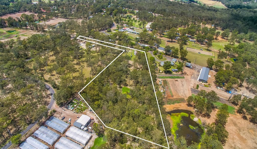 Exceptional 5 Acres + Town Water
