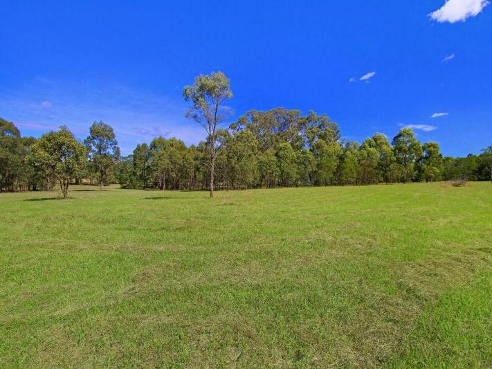 Magnificent 24 Vacant Acres with Water